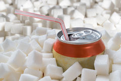 Carbonated soda drink with many sugar cubes. Unhealthy eating concept.  Royalty Free Stock Image