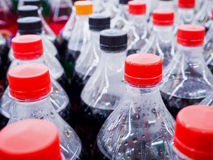 Carbonated soft drink bottles. Close up Royalty Free Stock Photography