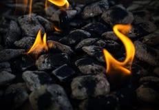 Carbones ardientes Fotos de archivo