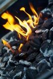 Carbones del Bbq en el fuego Imagen de archivo libre de regalías
