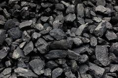 Carbones negros naturales para el fondo Carbones industriales Imagen de archivo