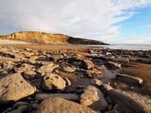 Carboniferous layers of limestone and shale cliffs at Dunraven Bay, Vale of Glamorgan, South Wales royalty free stock photo