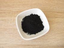 Carbonio attivato terra Fotografia Stock