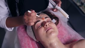 Carboxytherapy for young woman in professional spa salon. Young woman is lying on the couch while professional. Cosmetologist is apllying special treatment on stock video footage