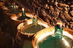 Carboys in cellar Stock Images