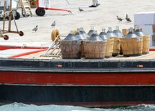 Carboys full of wine carried in a boat Royalty Free Stock Image
