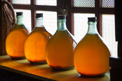 Carboys. With hand made liqueur Stock Photography