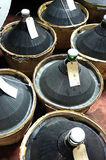 Carboys and wooden barrels filled  wine Royalty Free Stock Photo