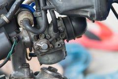 Carburador viejo de la máquina de la motocicleta sucio Foto de archivo libre de regalías