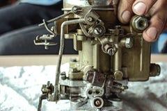 Carburador viejo en la tabla Foto de archivo libre de regalías