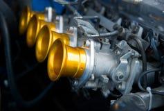 Carburatori del motore classico della vettura da corsa Immagini Stock