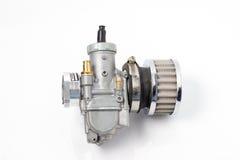 Carburetor and air filter. Big carburetor and naked air filter Royalty Free Stock Photo