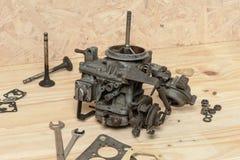 Carburetor. Closeup old and dirty carburetor on wooden desk Stock Photos
