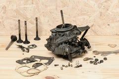Carburetor. Closeup old and dirty carburetor on wooden desk Royalty Free Stock Image