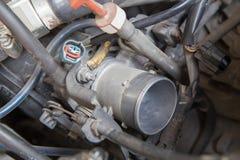 Carburetor of old car. Open car maintenance time Stock Image
