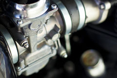 Carburetor. Old machine fueling system called carburetor isolated on a black engine background Royalty Free Stock Photo