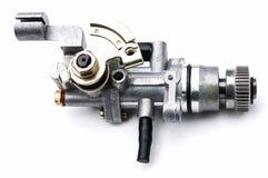 Carburetor på en vitbakgrund Arkivbilder