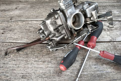 Carburetor and screwdrivers Stock Photo