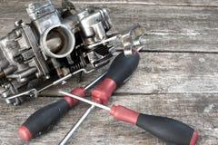 Carburetor and screwdrivers Stock Photo