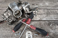 Carburetor and screwdrivers Royalty Free Stock Images