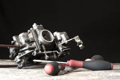 Carburetor and screwdrivers Royalty Free Stock Photos