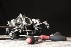 Carburetor and screwdrivers Royalty Free Stock Photos