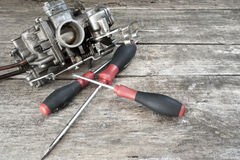 Carburetor and screwdrivers Stock Image