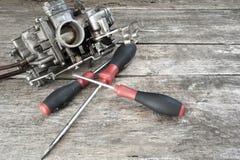 Carburetor and screwdrivers Stock Image
