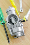 Carburetor and tool in modify. Royalty Free Stock Images