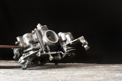 Carburetor on wooden surface Royalty Free Stock Photos