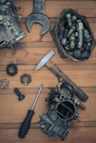 Carburetors for a car engine with tools Royalty Free Stock Image