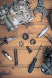 Carburetors for a car engine with tools Royalty Free Stock Photos