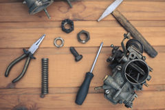 Carburetors for a car engine with tools Royalty Free Stock Images