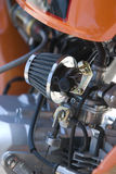 Carburettor of small, racing motorbike Stock Image
