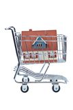 Carcass house in shopping cart Royalty Free Stock Images