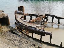 The carcass of a  iron vessel anchored in a river Royalty Free Stock Images