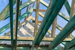 Carcass of the roof in house. Under construction Royalty Free Stock Photo