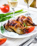 Carcasses of quail. With tomatoes and wine stock image
