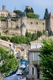 CARCASSON, FRANCE - JULY 7, 2016: Train at strret in Carcassone against medieval fortress, it was added to the UNESCO list of Worl. CARCASSON, FRANCE - JULY 7 stock image