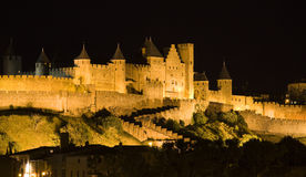 Carcassone at Night. The illuminated walls and towers of the medieval city of Carcassonne, France Royalty Free Stock Photo