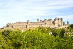 Carcassonne castle in France with some trees. In front of it royalty free stock photo