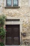 Carcassonne citadella door. Door , window , stoned wall in medieval town Royalty Free Stock Image