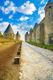 Carcassonne Cite, medieval fortified city on sunset. Unesco site, France Royalty Free Stock Images