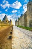 Carcassonne citerar, den medeltida stärkte staden på solnedgång. Unesco-plats, Frankrike Royaltyfria Bilder