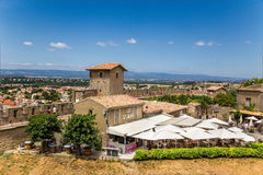 Carcassonne, France. Summer restaurant in the upper town on the background of fortifications Stock Images