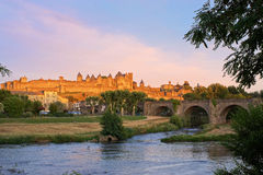 Carcassonne, France at Sunset. The fortified city of Carcassonne and the Pont Vieux viewed from across the Aude river at sunset stock photos