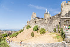 Carcassonne, France. Tourists visiting the picturesque medieval fortress constructions. UNESCO list Royalty Free Stock Photos
