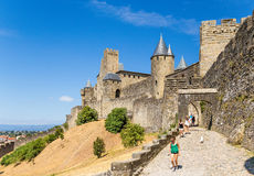 Carcassonne, France. Tourists visiting the picturesque medieval fortress. UNESCO list Royalty Free Stock Photo