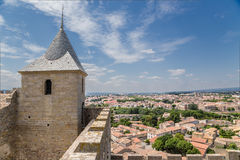 Carcassonne, France. Tower and fortification against the backdrop of lower town Stock Image