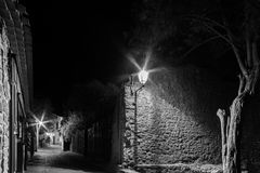 Carcassonne medieval city street night view in black and white Royalty Free Stock Photography